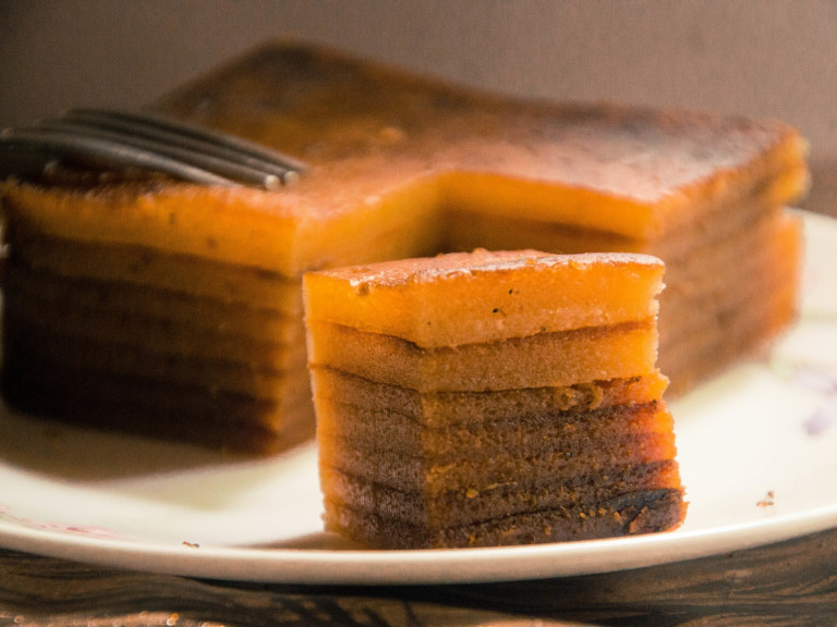 a portuguese layer cake, with a single serve in forground