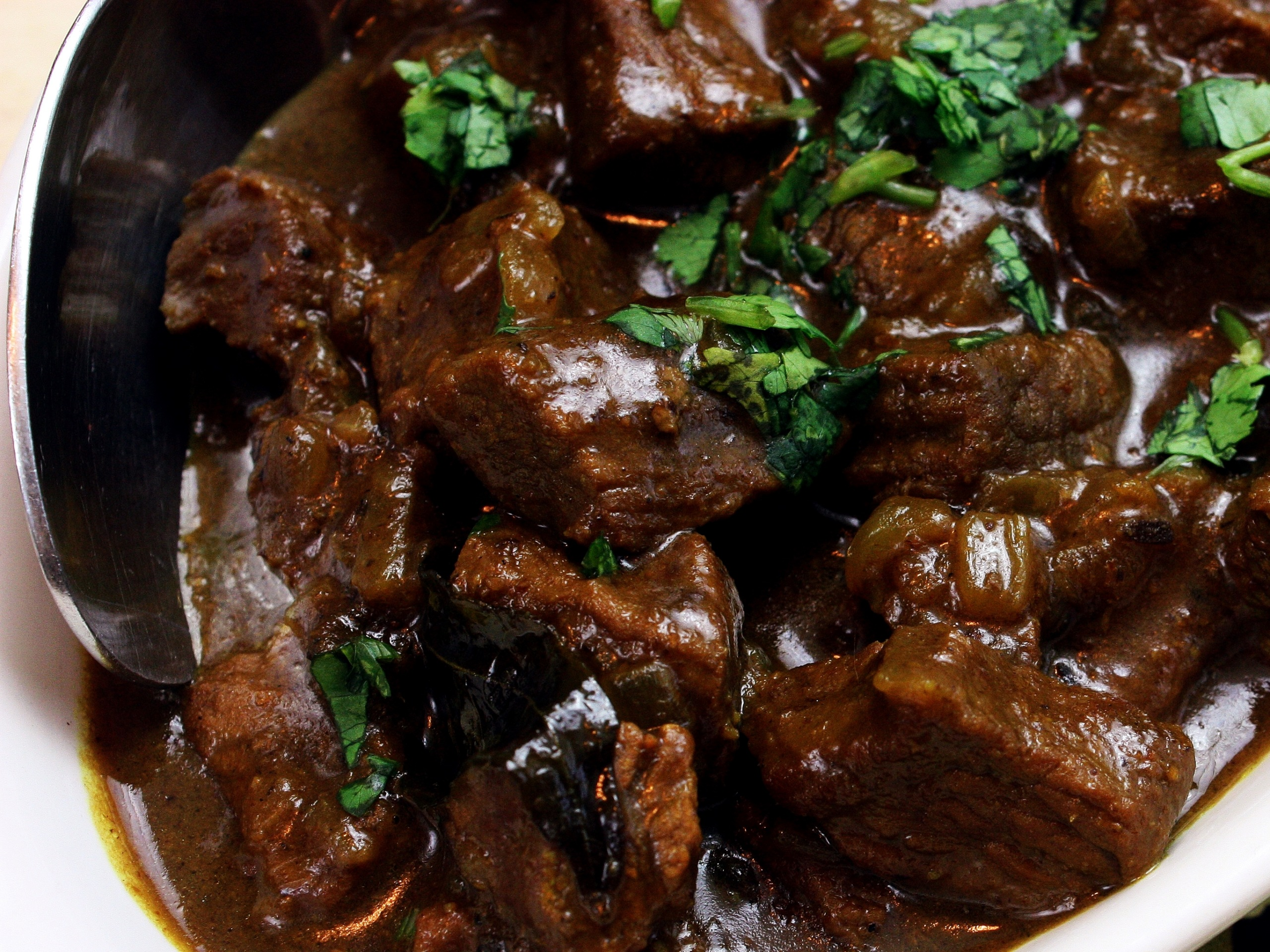 a bowl of beef with tamarind and ginger curry