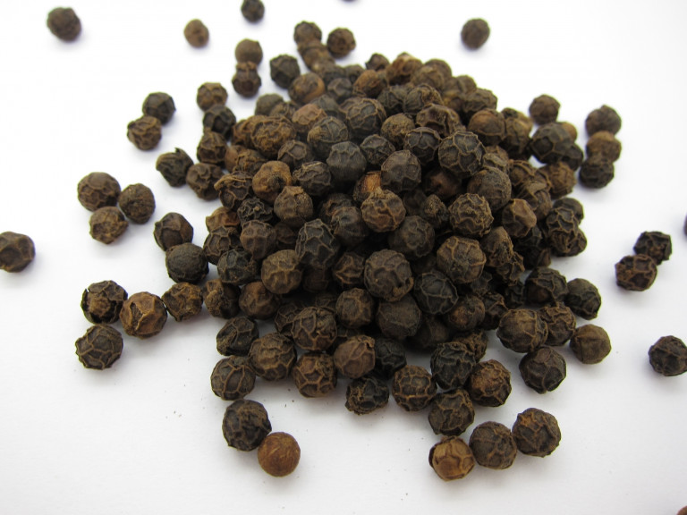 a small mound of black peppercorns