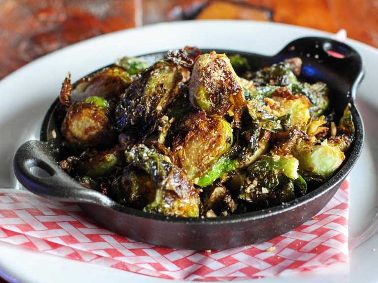 a serving dish, filled with pan-roasted brussel sprouts