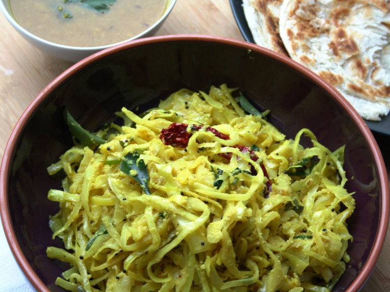 a serving bowl filled with cabbage poriyal