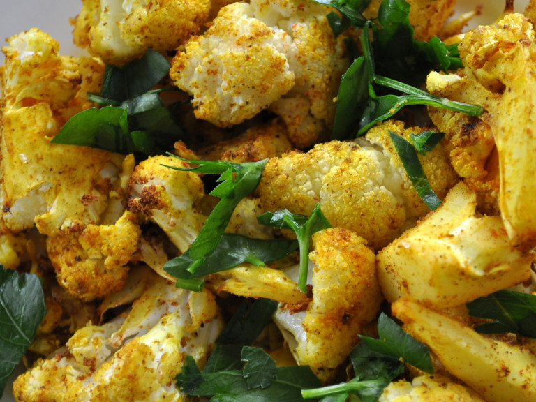 a serving dish of roasted cauliflower florets