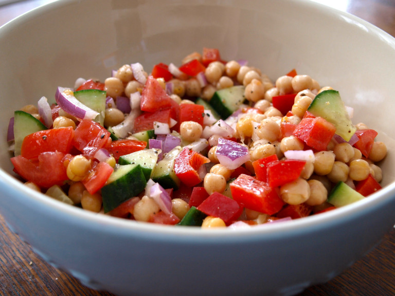 a bowl of chickpea, tomato and onion salad
