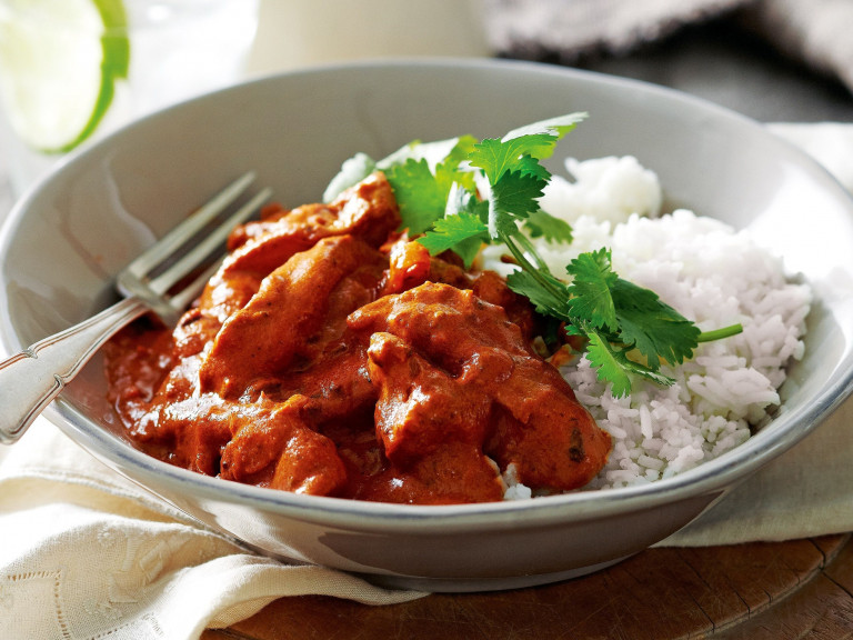 a bowl of butter chicken with rice