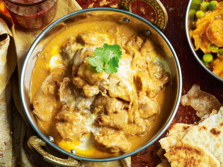 a serving bowl of northern style chicken korma