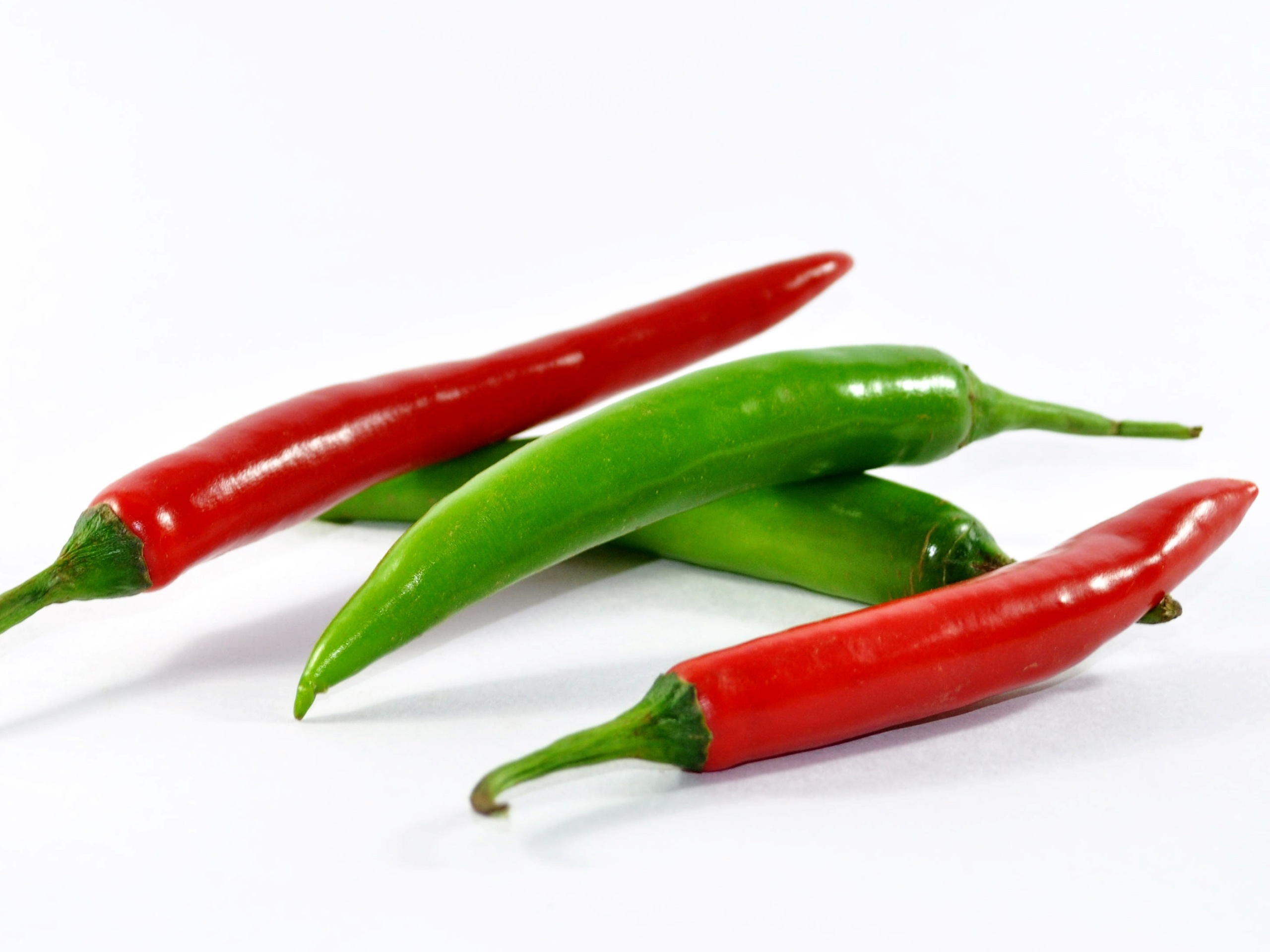 two red and two green whole chillies