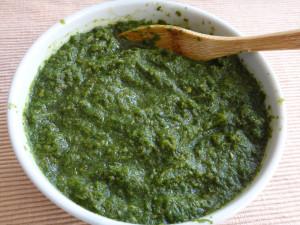 a bowl of green chutney