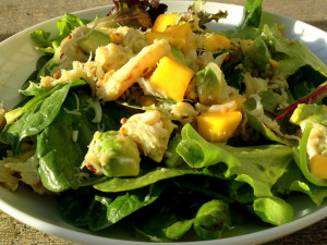 a small platter of crab, mango and coconut salad