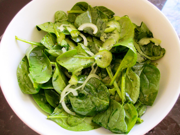serving platter of cucumber and spinach salad with yoghurt dressing