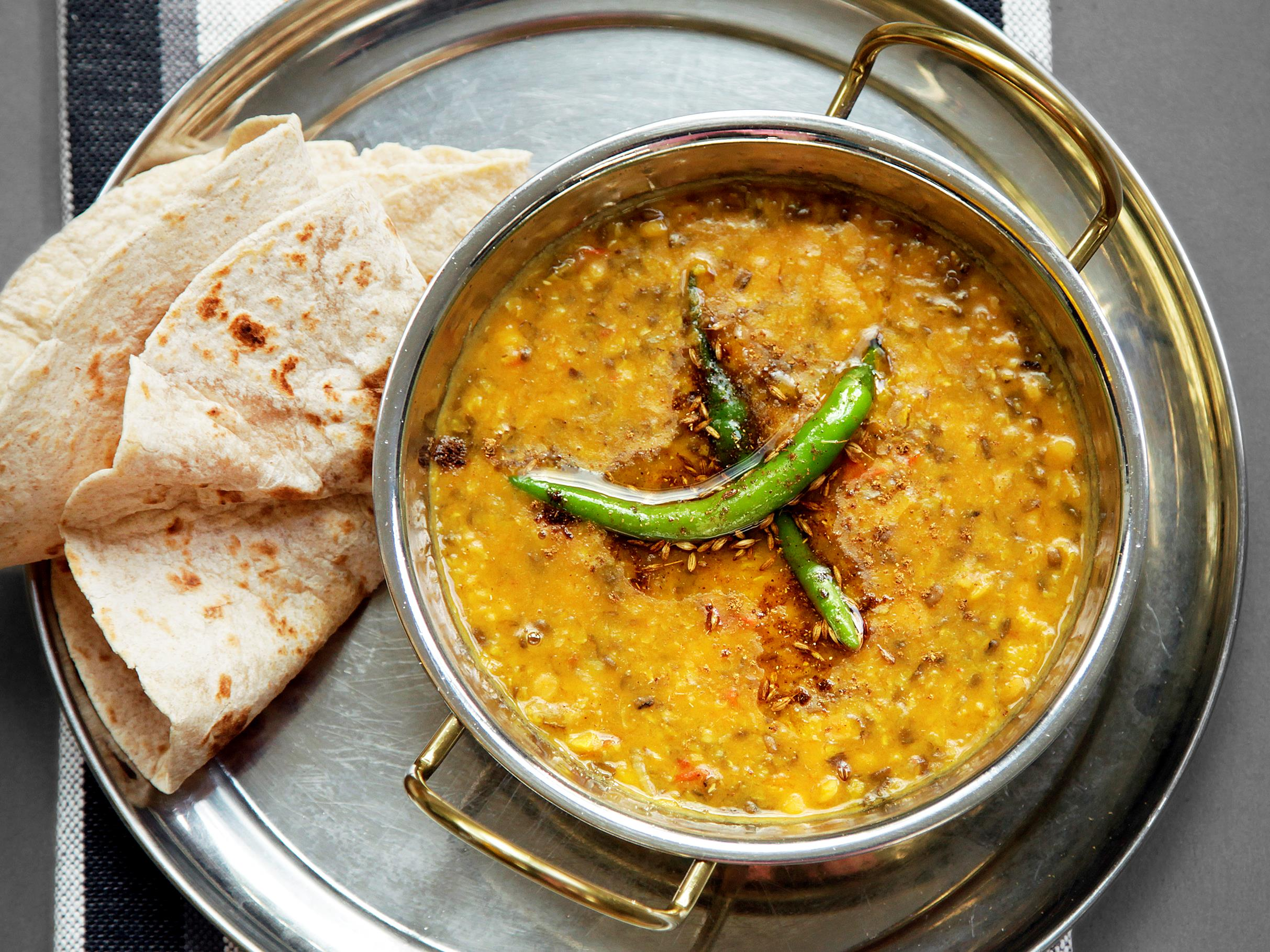 a bowl of Hyderabadi mixed dal on a platter with roti