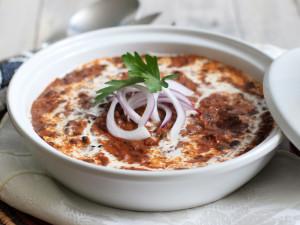 a serving bowl of dal makhani