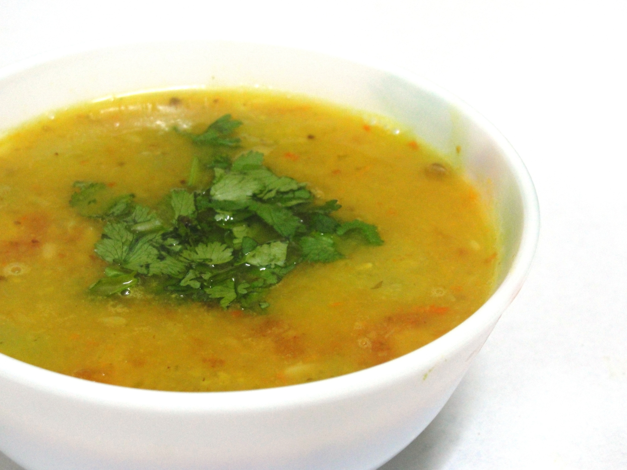 a serving bowl of yellow dal
