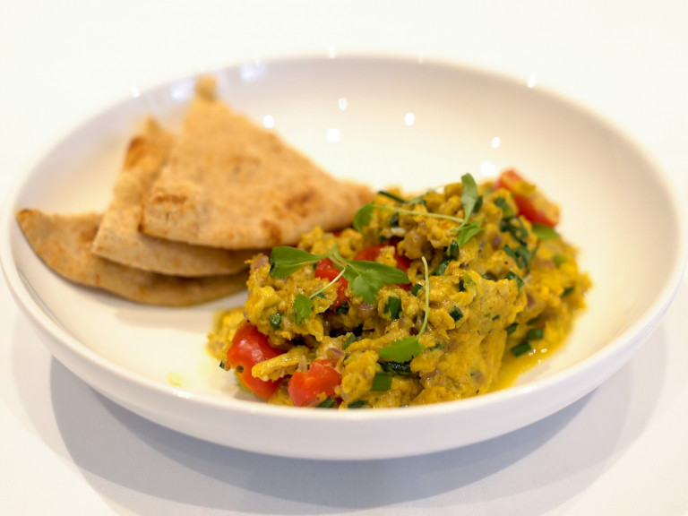 a bowl, with Parsi scrambled eggs and a roti