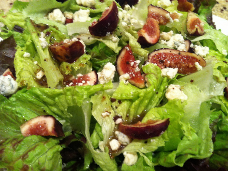 a bowl of fig, almond and lettuce salad