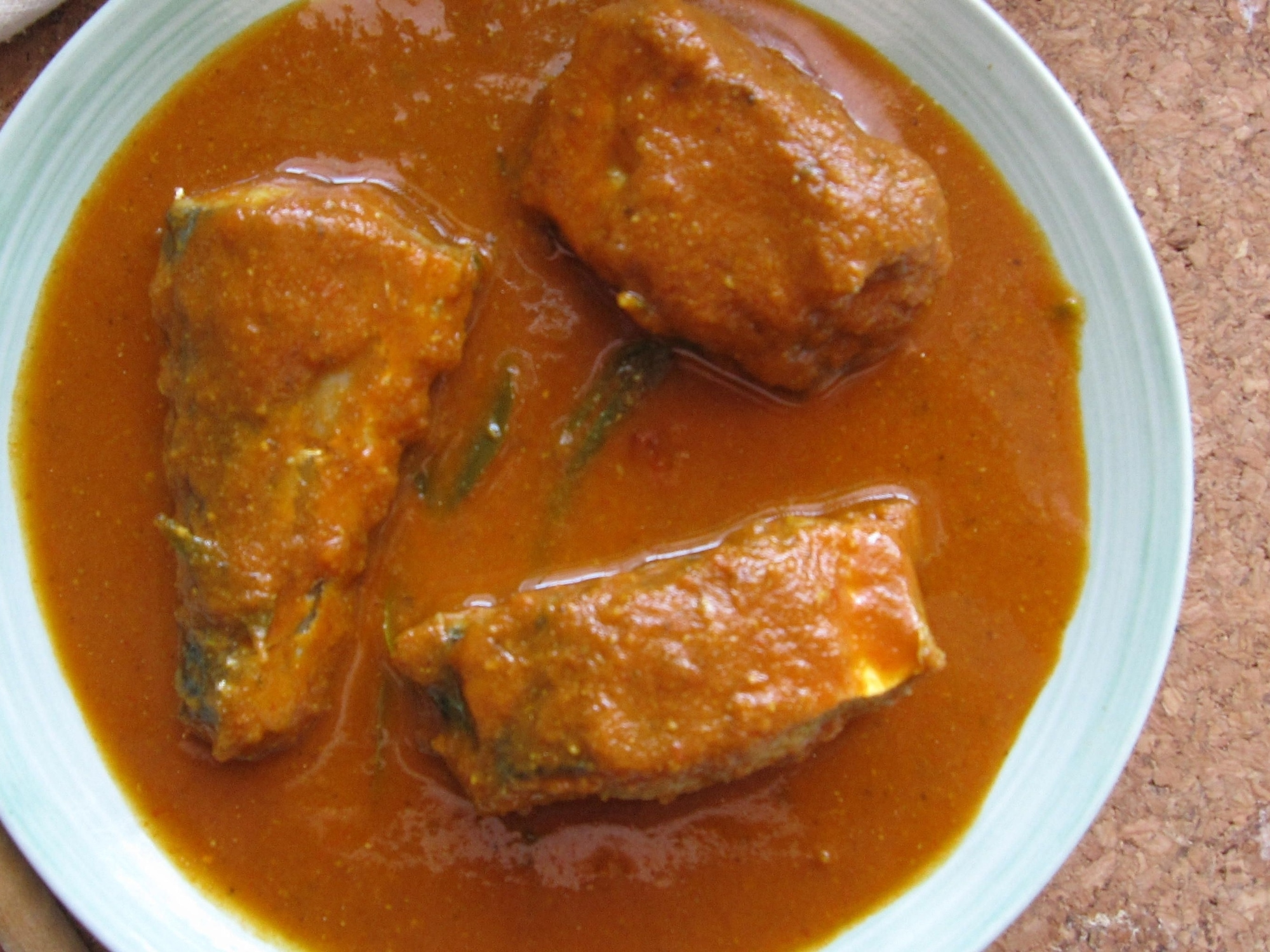 A bowl of goan fish curry