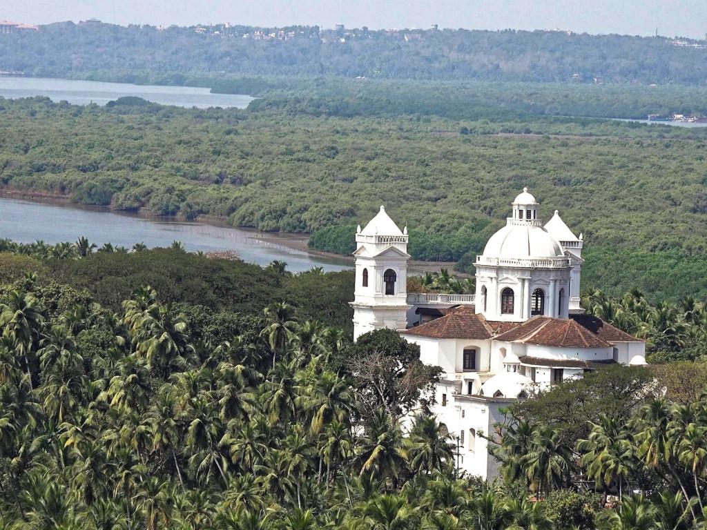 Portuguese colonial church set in tropical Goan landscape