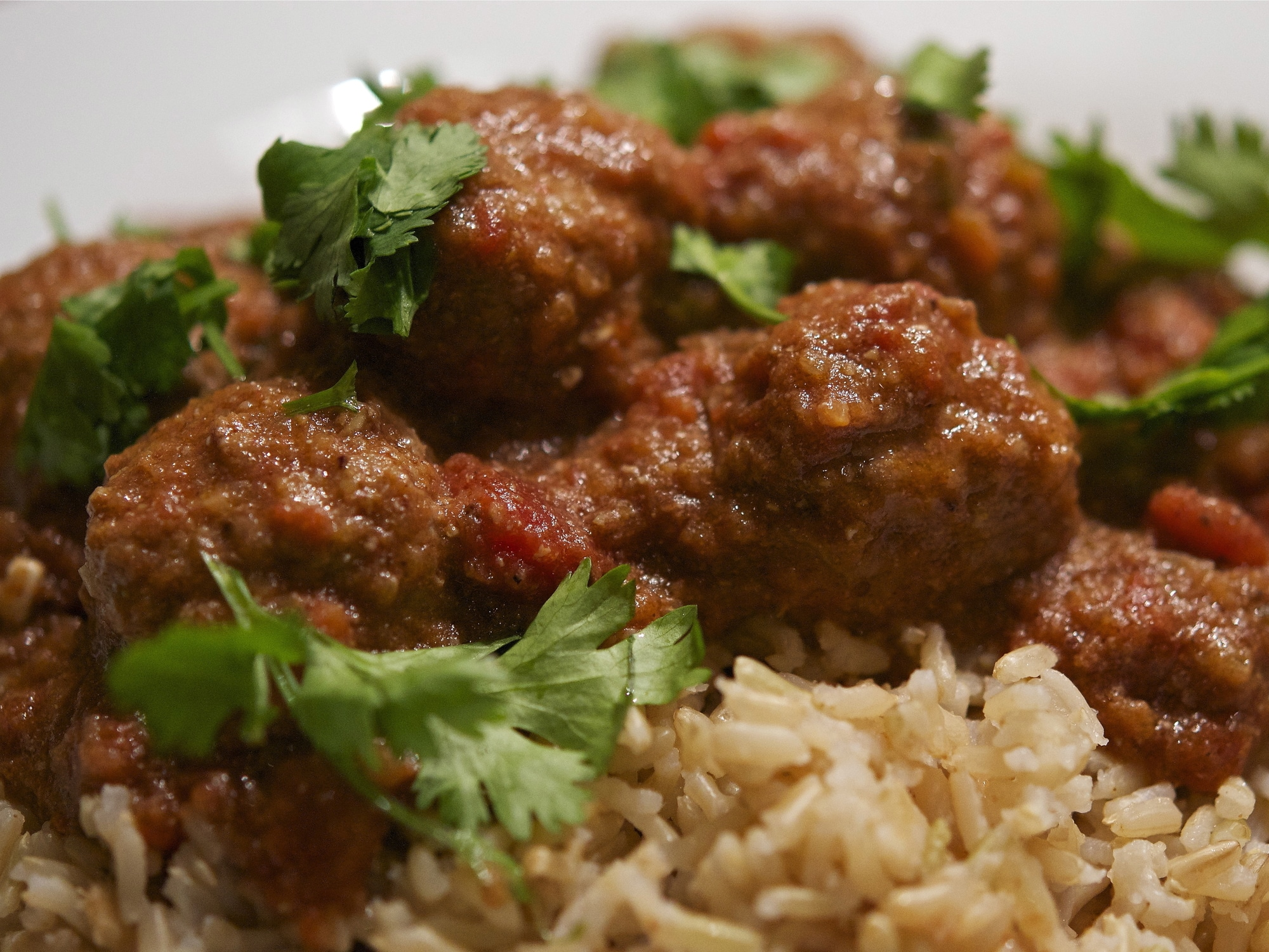 lamb kofta curry on a bed of rice