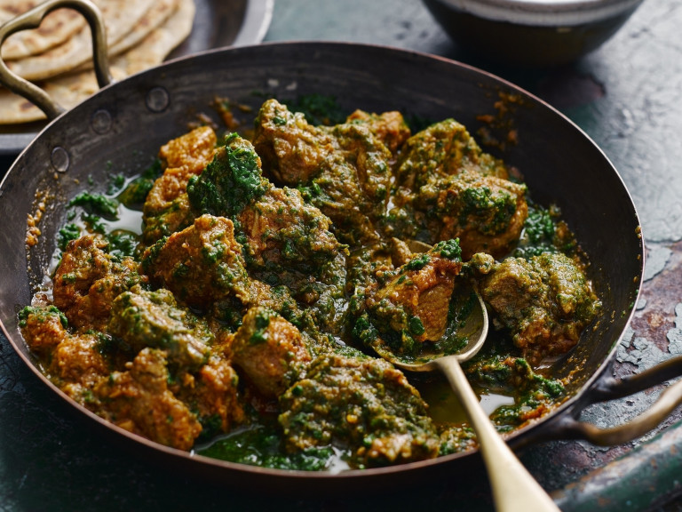 a serving bowl of lamb saag