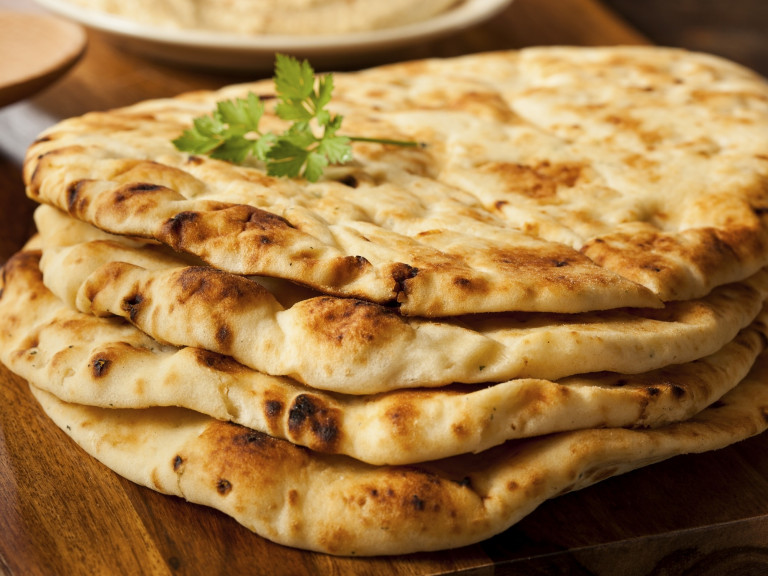 a stack of naan on a wooden platter