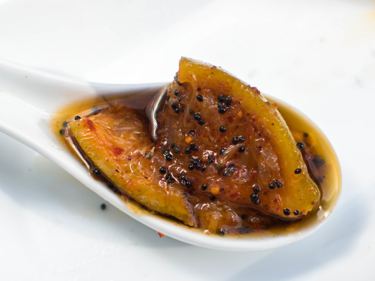 a serving spoon of hot lime pickle