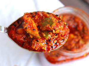 a serving spoon of grated mango pickle