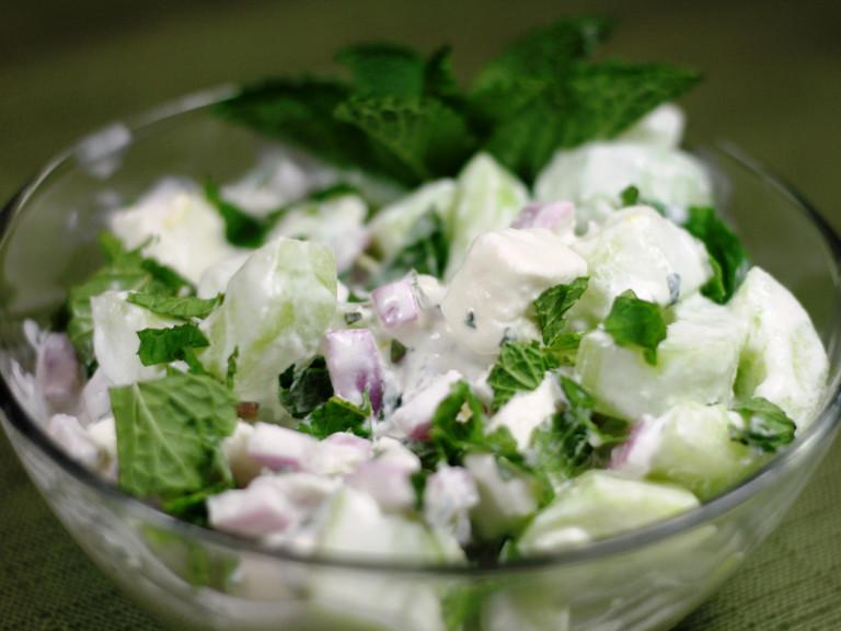 a serving bowl of cucumber raita