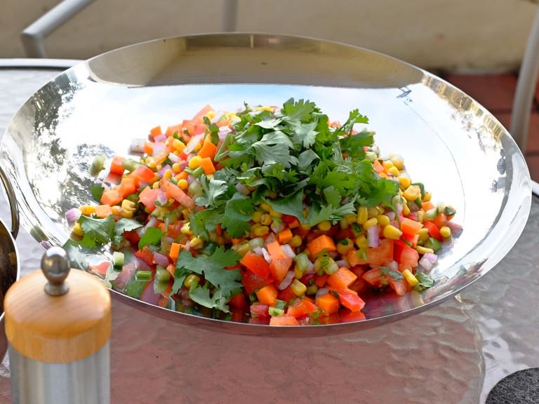 a platter of corn salad