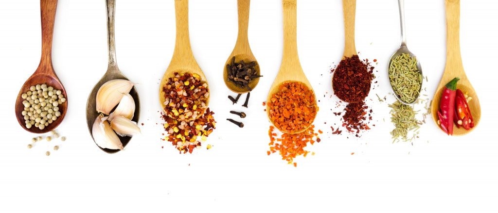 spice on wooden spoons