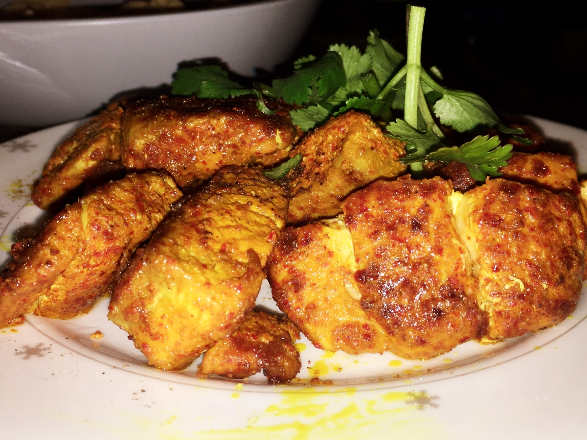 a plate of fish tikka pieces